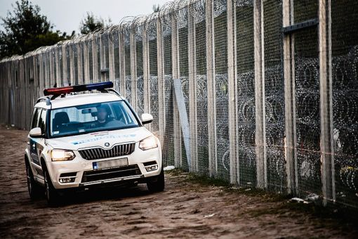 police_car_at_hungary-serbia_border_barrier
